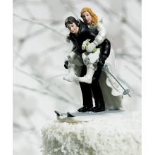 figuras de novios esquiando esquiando