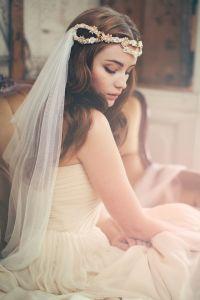 Novia romántica con velo de tul. Vía Pinterest.