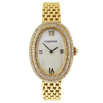 Reloj de oro de Cartier. Vía Pinterest.