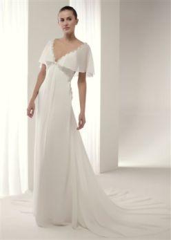 Vestido de novia Badet Innovias confeccionado en gasa con corte imperio, manguitas y escote trasero.