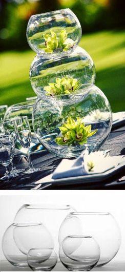 Cesntros de mesas con peceras de vidrio. Vía Pinterest.