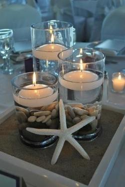 Centro de mesa con detalles del mar para una boda en la playa. Vía Pinterest.