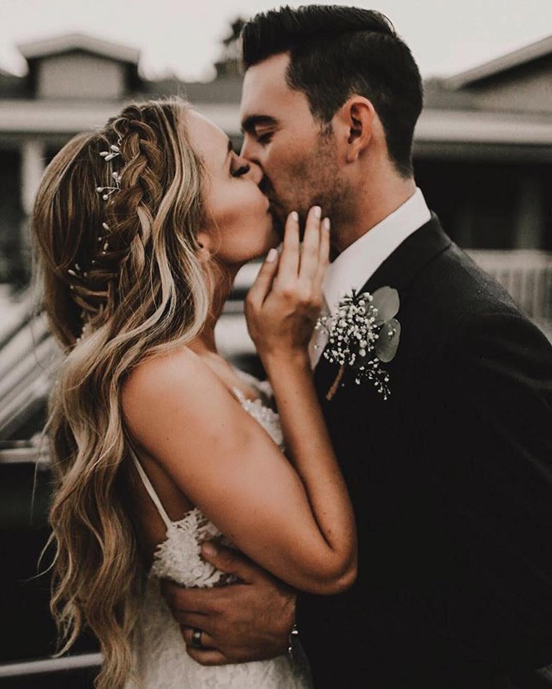 Pareja de novios en la boda. Foto: Michaela M. Photography